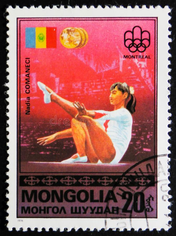 A post stamp printed in Mongolia shows Nadia Comaneci, circa 1976. MOSCOW, RUSSIA - APRIL 2, 2017: A post stamp printed in Mongolia, shows Nadia Comaneci, from royalty free stock image