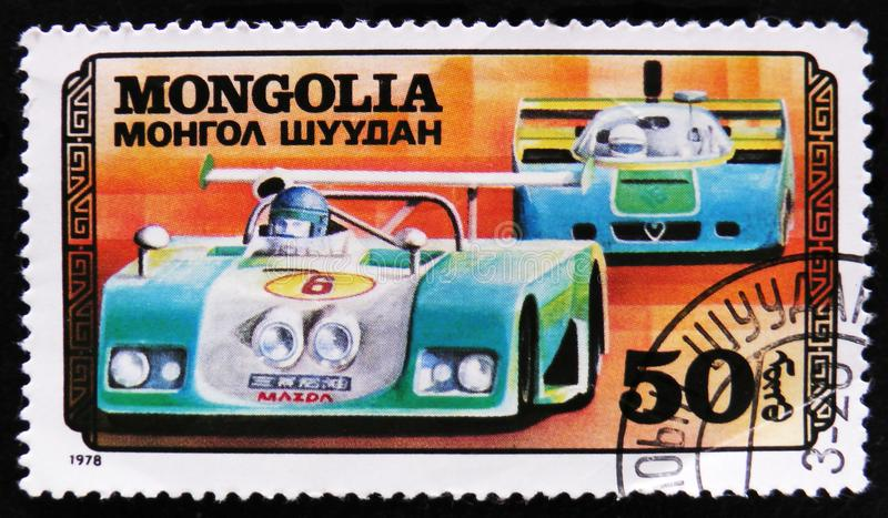 Sport racing car, Car racing serie, circa 1978. MOSCOW, RUSSIA - APRIL 2, 2017: A post stamp printed in Mongolia shows sport racing car, Car racing serie, circa royalty free stock images