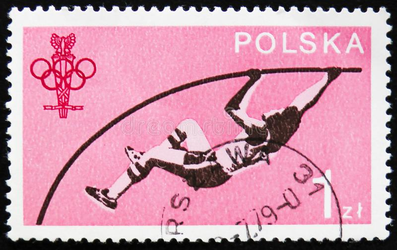 MOSCOW, RUSSIA - APRIL 2, 2017: A post stamp printed in Poland s. Hows Pole vault sportsman, circa 1979 stock photos