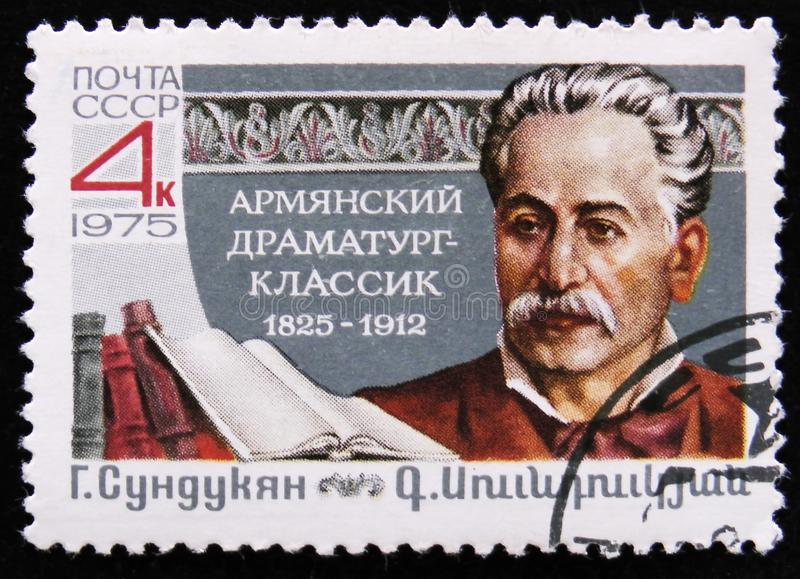 Armenian playwright G. Sundukyan, circa 1975. MOSCOW, RUSSIA - APRIL 2, 2017: A post stamp printed in USSR, shows Armenian playwright G. Sundukyan, circa 1975 stock images