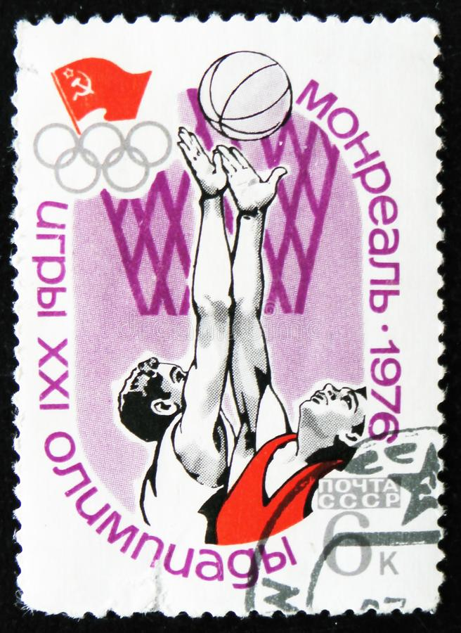 Basketball, Olympic games in Montreal, Canada, circa 1976. MOSCOW, RUSSIA - APRIL 2, 2017: A post stamp printed in USSR shows Basketball, Olympic games in royalty free stock photos