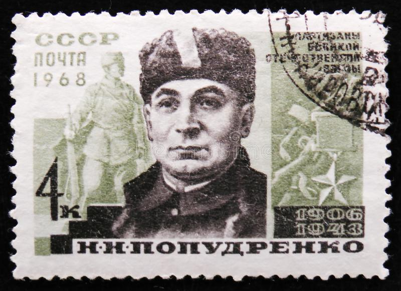 Portrait of N. Popudrenko, partisan heroes of world war II, circa 1968. MOSCOW, RUSSIA - APRIL 2, 2017: A post stamp printed in USSR shows portrait of N royalty free stock photos