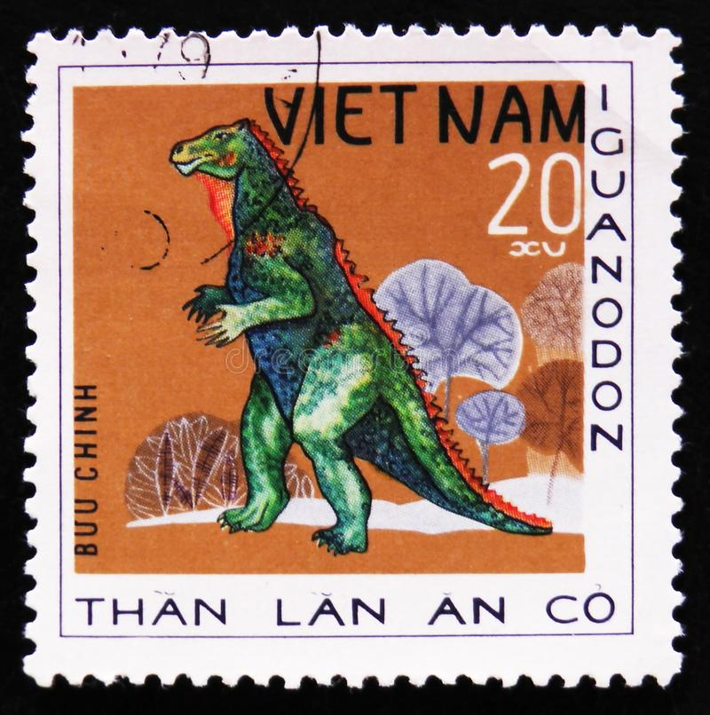 Dinosaur Iguanodon, series Prehistoric animals, circa 1978. MOSCOW, RUSSIA - APRIL 2, 2017: A post stamp printed in Vietnam shows dinosaur Iguanodon, series stock photos