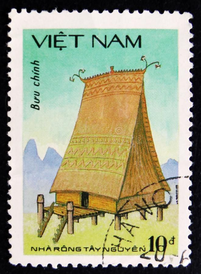 MOSCOW, RUSSIA - APRIL 2, 2017: A post stamp printed in Vietnam. Shows Highland House - Highest house style in Vietnam, Nha rong tay nguyen, circa 1963 stock photos