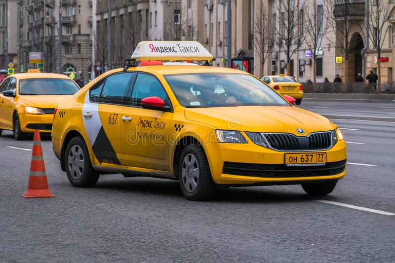 MOSCOW, RUSSIA,APRIL,5.2019:Taxi in motion on the highway of a megapolis royalty free stock image