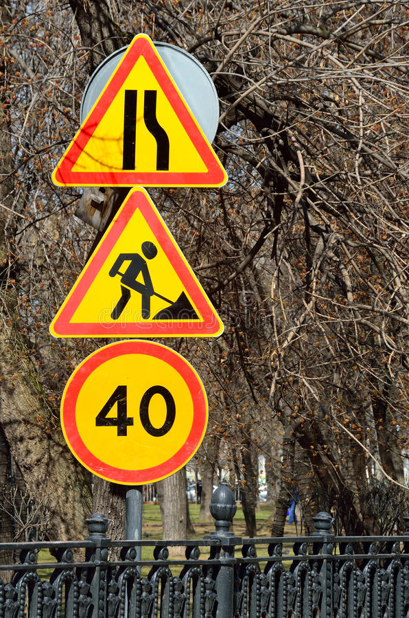 Moscow, Russia, April, 15, 2017. Temporary road signs `road narrows ahead`, `Road works`, `speed Limit 40 km/h` on Chistoprudny Bo. Ulevard in Moscow royalty free stock image
