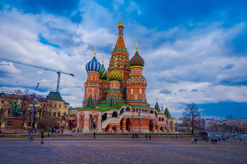 MOSCOW, RUSSIA- APRIL, 29, 2018: Unidentified people walking at the Red Square, Kremlin and St Basil`s Cathedral in royalty free stock images