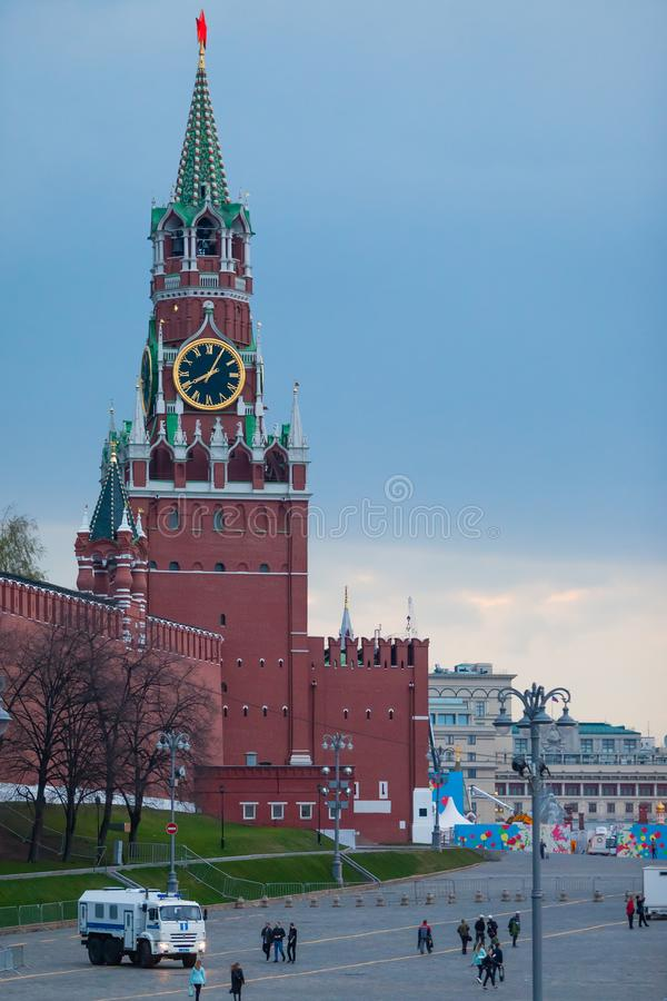 MOSCOW, RUSSIA - APRIL 30, 2018: View of the Spasskaya Tower of the Moscow Kremlin and the Bolshoy Moskvoretsky Bridge. Police bus. MOSCOW, RUSSIA - APRIL 30 stock images