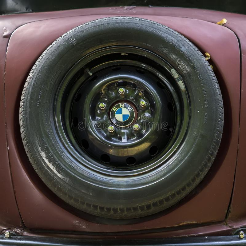 MOSCOW, RUSSIA - AUGUST 26, 2017: Close-up of BMW spare wheel and famous Logo, vintage auto. Retro motor vehicles stock images