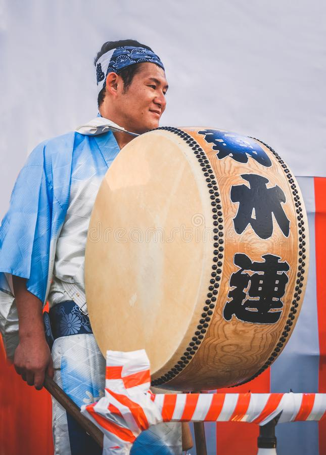 Moscow, Russia - August 09, 2018: Japanese artist perform at Bon Festival in blue kimono with big drum odaiko on royalty free stock photo