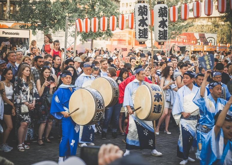 Moscow, Russia - August 09, 2018: Japanese artist perform at Bon Festival in blue kimono with big drum odaiko on stock photo