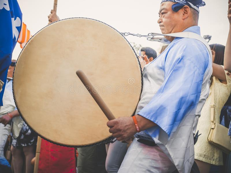 Moscow, Russia - August 09, 2018: Japanese artist perform at Bon Festival in blue kimono with big drum odaiko on stock images