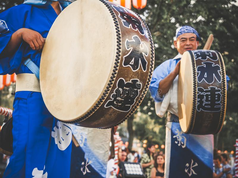 Moscow, Russia - August 09, 2018: Japanese artists perform at Bon Festival in blue kimono with big drum odaiko on festival of Japa royalty free stock photos
