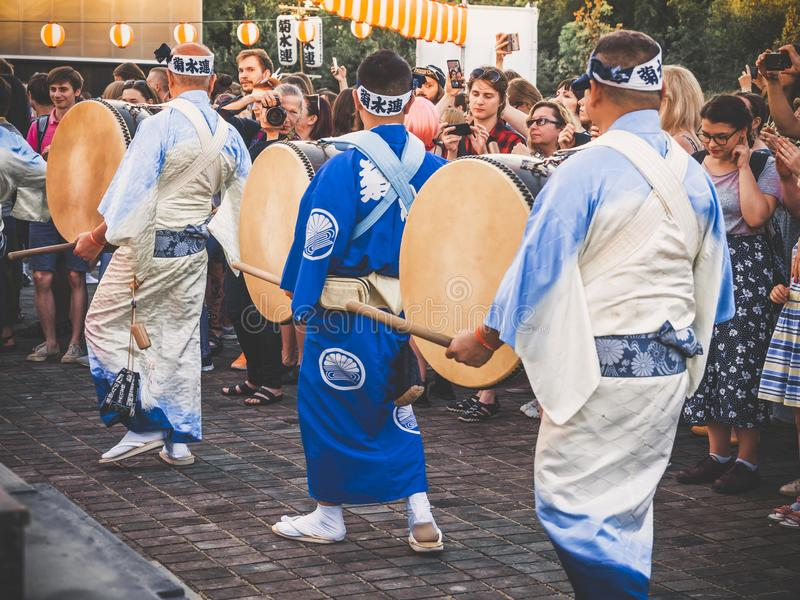Moscow, Russia - August 09, 2018: Japanese artists perform at Bon Festival in blue kimono with big drum odaiko on stock photography