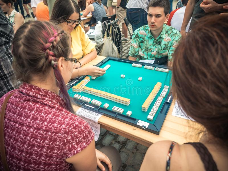 Moscow, Russia - August 09, 2018: Japanese festival in Moscow. Young people playing mahjong asian tile-based game. Table stock photo