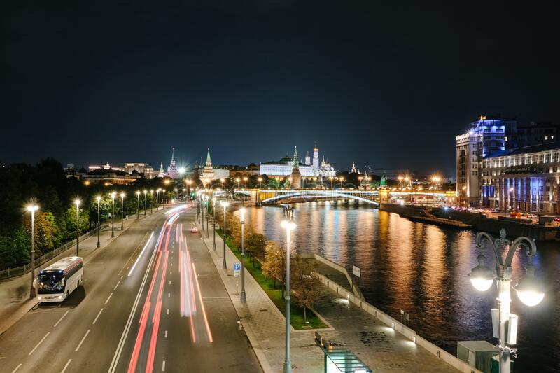 MOSCOW, RUSSIA - AUGUST, 2019: Moscow Kremlin and bridge through Moscow River at night royalty free stock photos