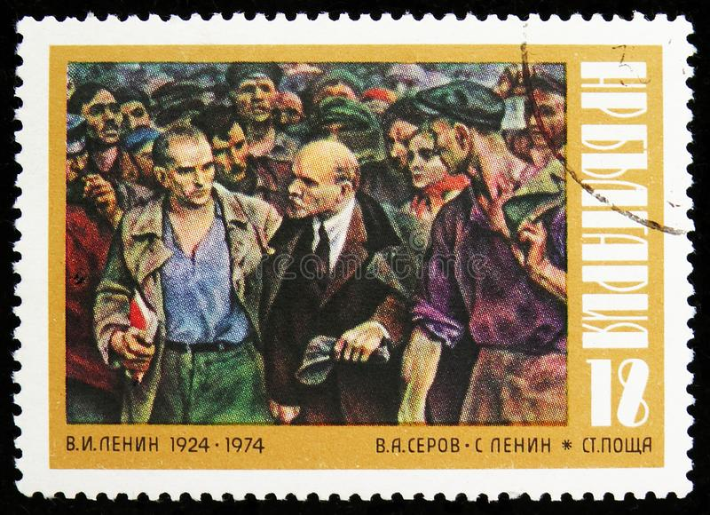 Lenin visited Workers, Painting by W. A. Serov, 50th Death of Lenin serie, circa 1974. MOSCOW, RUSSIA - AUGUST 6, 2019: Postage stamp printed in Bulgaria shows stock image