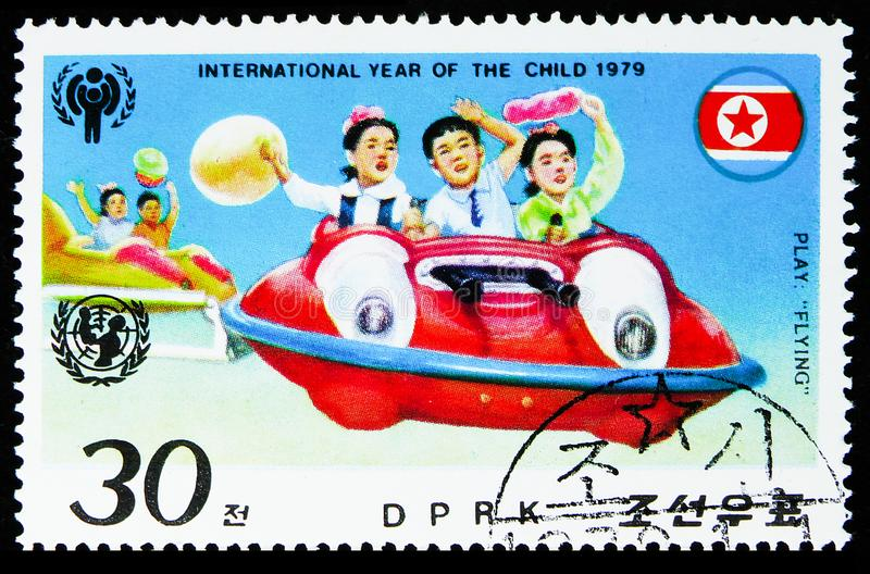 Children in carousel, International year of the Child (II) serie, circa 1979. MOSCOW, RUSSIA - AUGUST 6, 2019: Postage stamp printed in Korea shows Children in stock images
