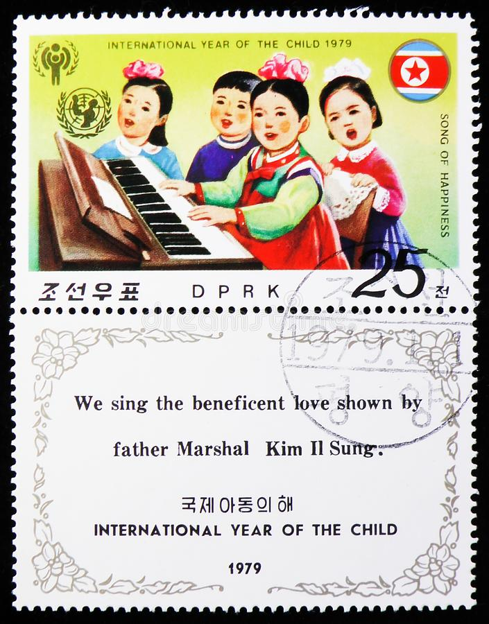 Children playing piano and singing, International year of the Child (II) serie, circa 1979. MOSCOW, RUSSIA - AUGUST 6, 2019: Postage stamp printed in Korea shows royalty free stock images