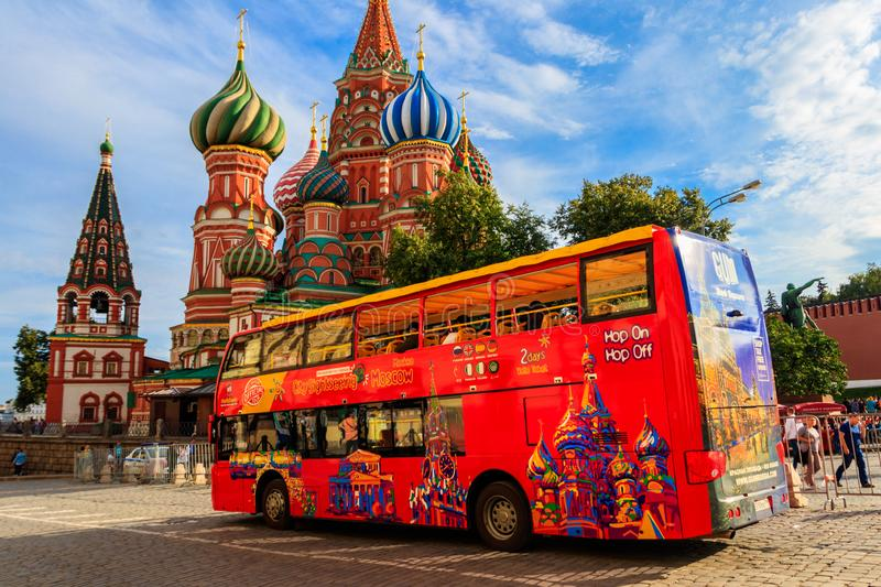 Red sightseeing double decker bus near St. Basil`s Cathedral on Red square in Moscow, Russia. Moscow, Russia - August 15, 2019: Red sightseeing double decker bus royalty free stock images