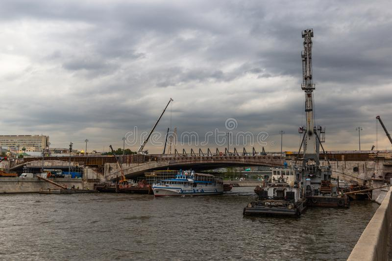 Moscow, Russia - August 12, 2019: Repair of the bridge. Work over the water stock photos