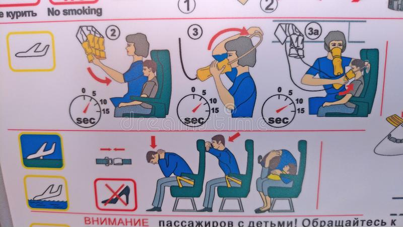 Moscow, Russia, August 5, 2018 Safety instruction aboard the Pobeda airplane. Emergency Landing and Evacuation on Water sign on. Safety instructions card in stock photos