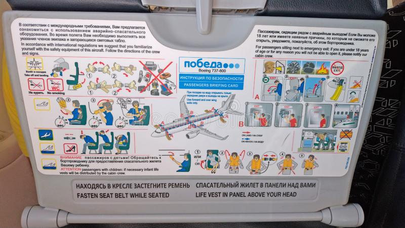 Moscow, Russia, August 5, 2018 Safety instruction aboard the Pobeda airplane. Emergency Landing and Evacuation on Water sign on. Safety instructions card in stock photo