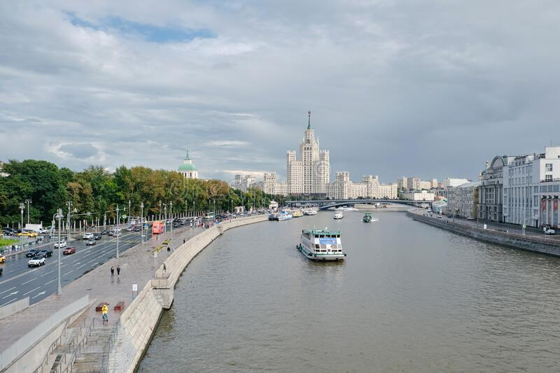 MOSCOW, RUSSIA - AUGUST, 2019: Scenic panorama Zaryadye Park overlooking river and Stalin skyscraper pleasure boat, Russia royalty free stock photos