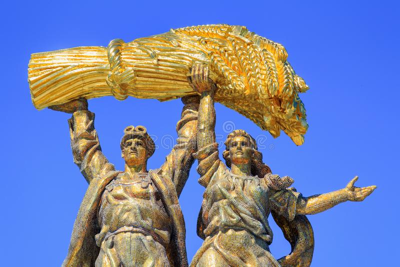 Moscow, Russia - August 01, 2018: Sculptural composition Tractor driver and collective farm girl closeup against blue sky on arch. Of Main entrance on VDNH in royalty free stock images