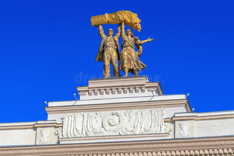 Moscow, Russia - August 01, 2018: Sculptural composition Tractor driver and collective farm girl on top of arch of Main entrance o. N Exhibition of Achievements royalty free stock photos