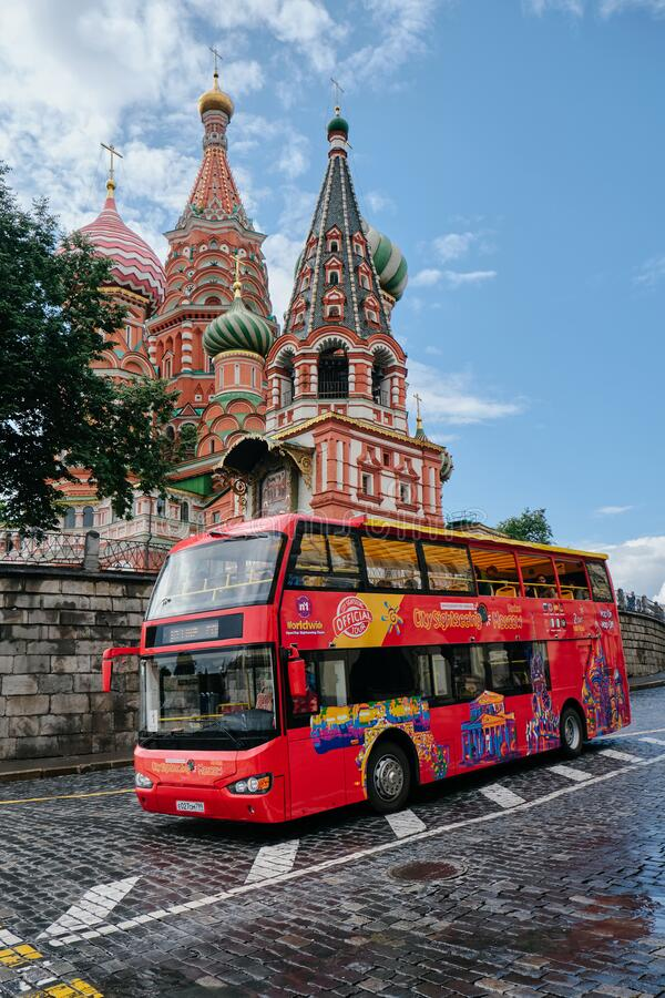 MOSCOW, RUSSIA -AUGUST, 2019: St. Basil`s Cathedral on Red Square in the Kremlin in Moscow and red tour bus royalty free stock images