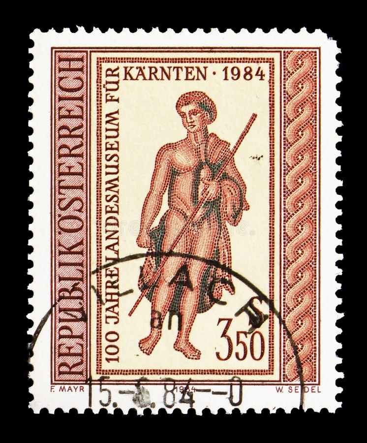 Dionysos, part of a Roman mosaic, Karnten State Museum serie, circa 1984. MOSCOW, RUSSIA - AUGUST 18, 2018: A stamp printed in Austria shows Dionysos, part of a stock image