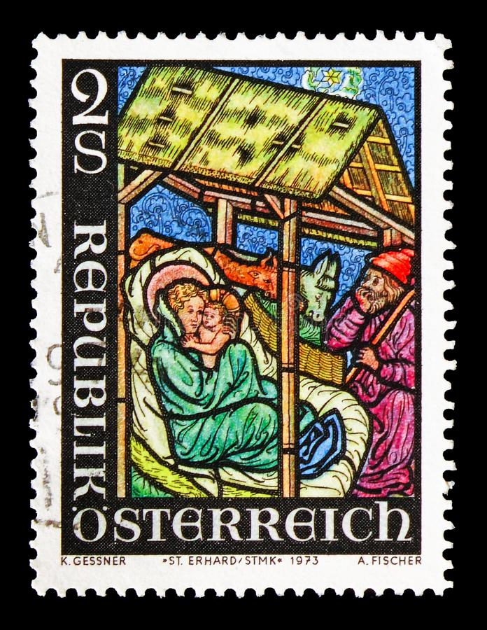 Gothic window with the birth of Christ, St. Erhard Church, Christmas serie, circa 1973. MOSCOW, RUSSIA - AUGUST 18, 2018: A stamp printed in Austria shows Gothic royalty free stock photo
