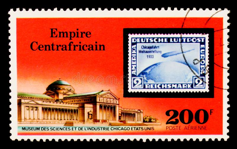 Museum of Science, Chicago and German Stamp, `Graf Zepplin` Flights serie, circa 1977. MOSCOW, RUSSIA - AUGUST 29, 2017: A stamp printed in Central African royalty free stock photo