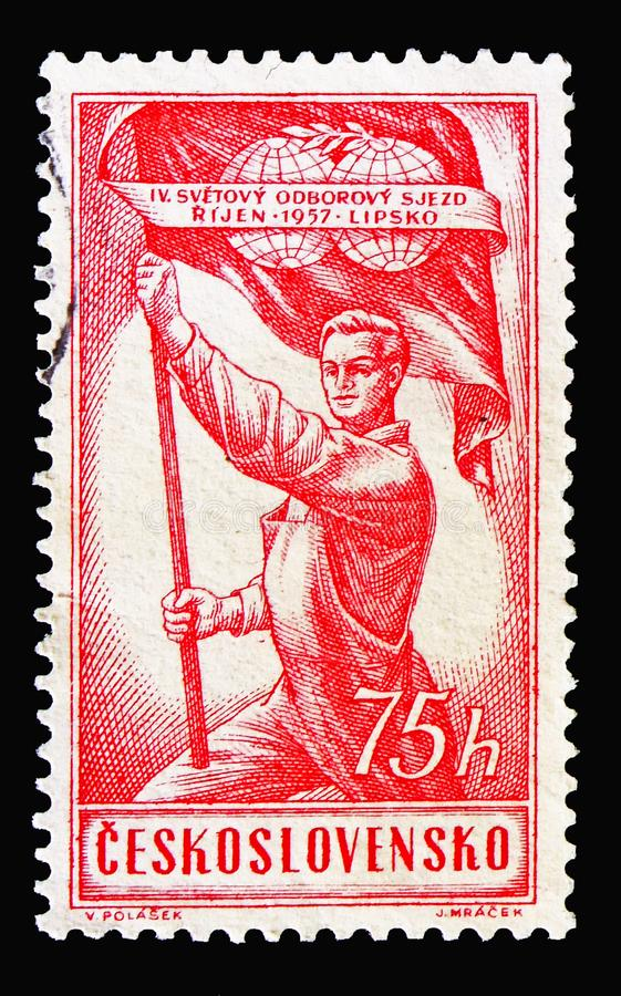 Trade Unions, 4th World Congress, serie, circa 1957. MOSCOW, RUSSIA - AUGUST 18, 2018: A stamp printed in Czechoslovakia shows Man hold flag, Trade Unions, 4th royalty free stock photography