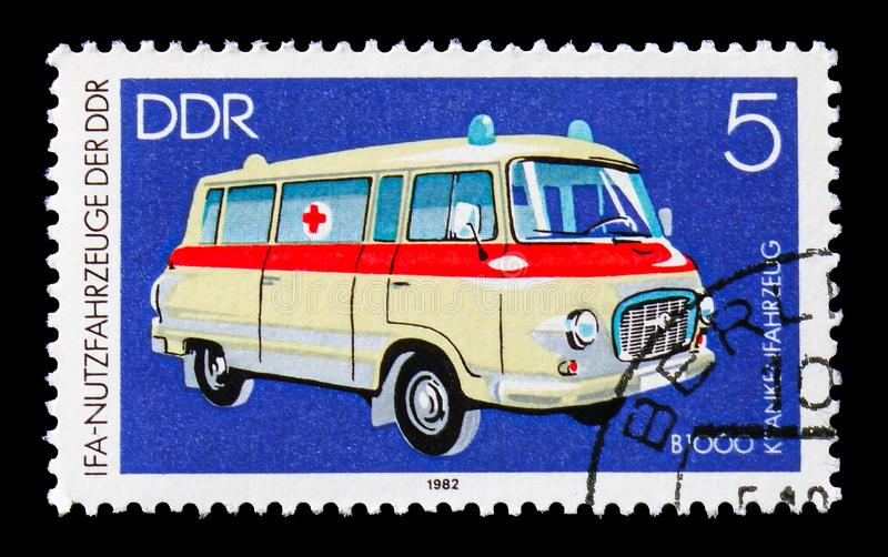 Ambulance Barkas B 1000, IFA: Commercial Vehicles serie, circa 1982. MOSCOW, RUSSIA - AUGUST 18, 2018: A stamp printed in Germany Democratic Republic shows royalty free stock images