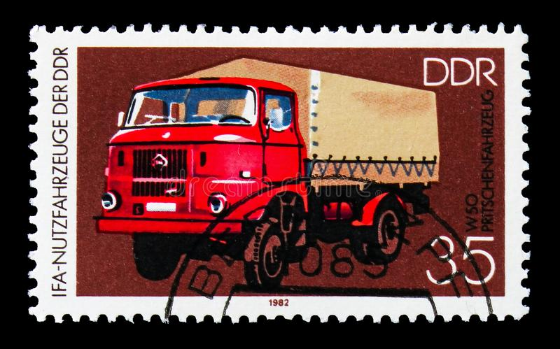 Flatbed Truck W 50, IFA: Commercial Vehicles serie, circa 1982. MOSCOW, RUSSIA - AUGUST 18, 2018: A stamp printed in Germany Democratic Republic shows Flatbed stock photo