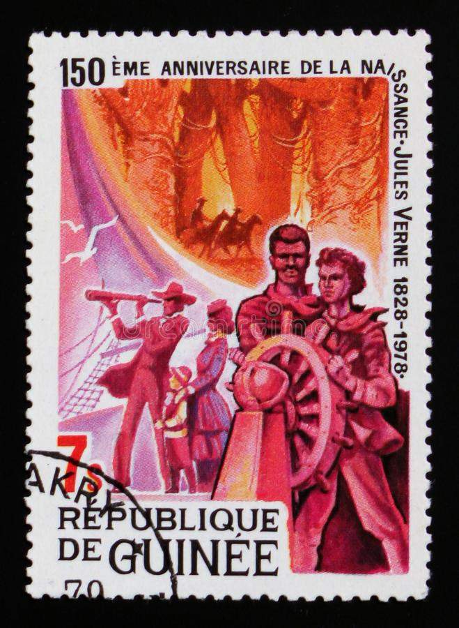 Birth of Jules Verne circa, 150th Anniversary of the birth of Jules Verne serie, circa 1979. MOSCOW, RUSSIA - AUGUST 29, 2017: A stamp printed in Guinea devoted royalty free stock photo