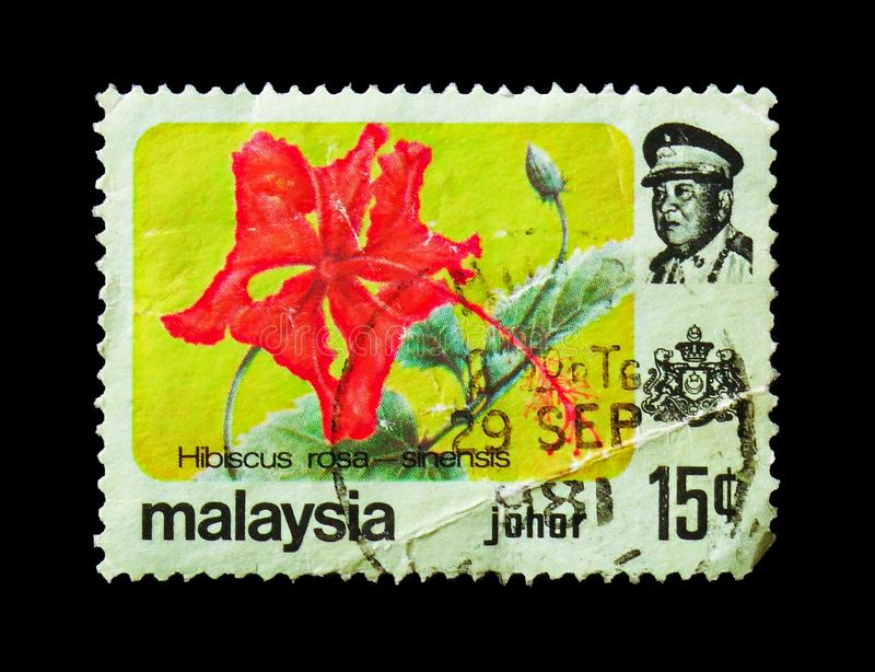 Hibiscus flower (Hibiscus rosa - sinensis), Johore serie, circa 1979. MOSCOW, RUSSIA - AUGUST 18, 2018: A stamp printed in Malaysia shows Hibiscus flower ( stock images