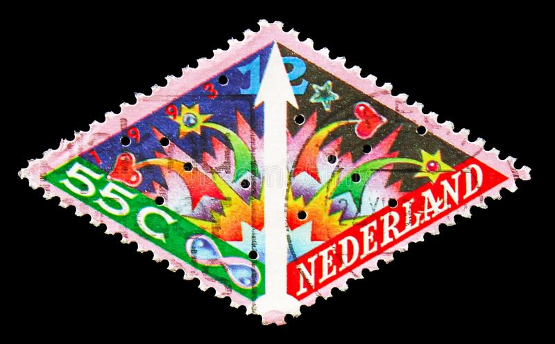 Candle and christmas tree, December stamps serie, circa 1993. MOSCOW, RUSSIA - AUGUST 18, 2018: A stamp printed in Netherlands shows Candle and christmas tree stock photos