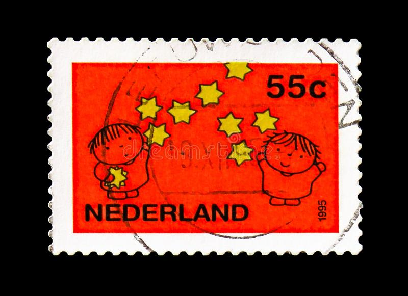 Children and star, Red, December stamps serie, circa 1995. MOSCOW, RUSSIA - AUGUST 18, 2018: A stamp printed in Netherlands shows Children and star, Red royalty free stock image