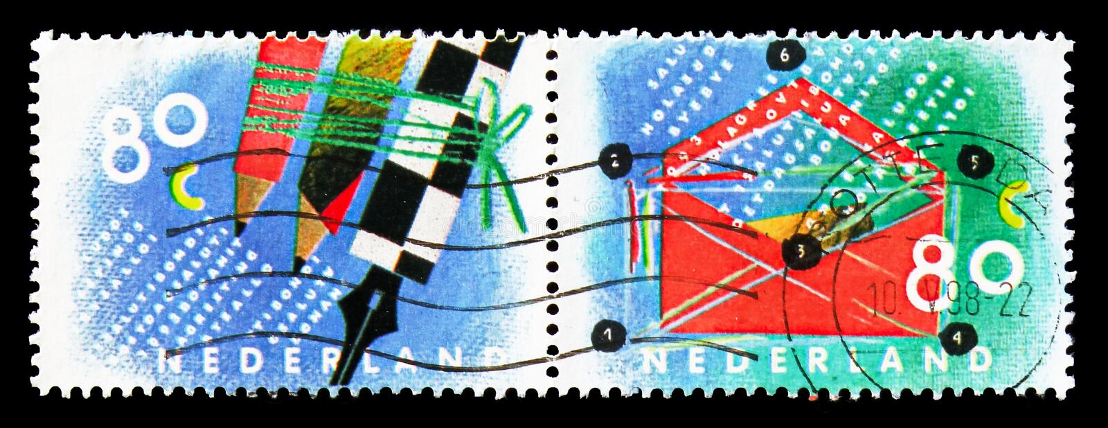 Writing mail, Ten for your letters serie, circa 1993. MOSCOW, RUSSIA - AUGUST 18, 2018: Two stamps printed in Netherlands shows Writing mail, Ten for your royalty free stock image