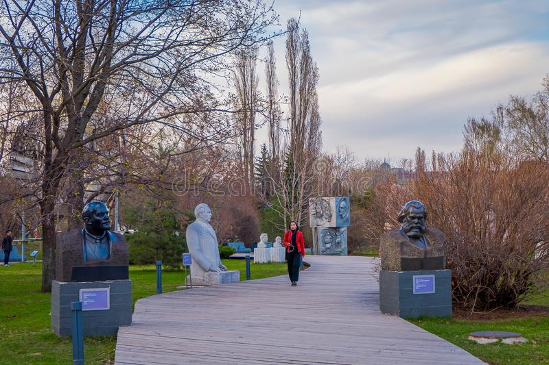 MOSCOW, RUSSIA - AUGUST 02, 2008: View of woman walking in MUZEON park of arts formerly called Park of the Fallen Heroes. Surrounding with trees and vegetation stock photography