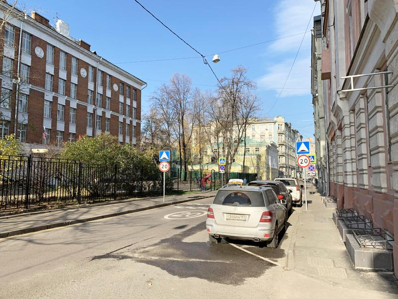 Moscow, Russia, October, 16, 2019. Cars are parked next to French school number 1225 in Lyalin lane in Moscow. Moscow, Russia. Cars are parked next to French stock images