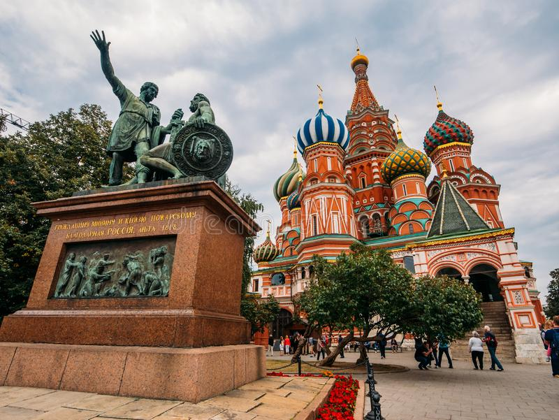 Moscow, Russia - CIRCA September 2016 : Monument to Minin and Pozharsky and St. Basil Cathedral on Red Square in Moscow, Russia royalty free stock photos