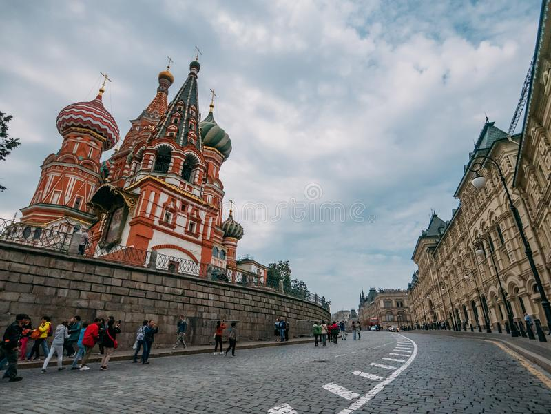Moscow, Russia - Circa September 2018 : Red Square near Kremlin, St. Basil Cathedral and tourists on street in Moscow royalty free stock images