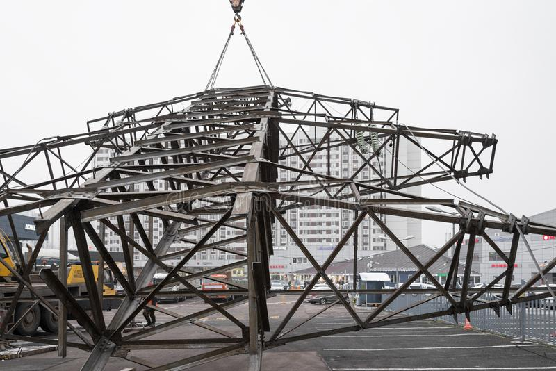 Moscow, Russia - December 21, 2017. The dismantling of the towers of high voltage lines in the city. The dismantling of the towers of high voltage lines in the royalty free stock images