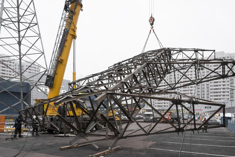 Moscow, Russia - December 21, 2017. The dismantling of the towers of high voltage lines in the city. The dismantling of the towers of high voltage lines in the royalty free stock photo