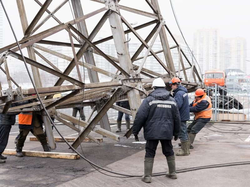 Moscow, Russia - December 21, 2017. The dismantling of the towers of high voltage lines in the city. The dismantling of the towers of high voltage lines in the stock image