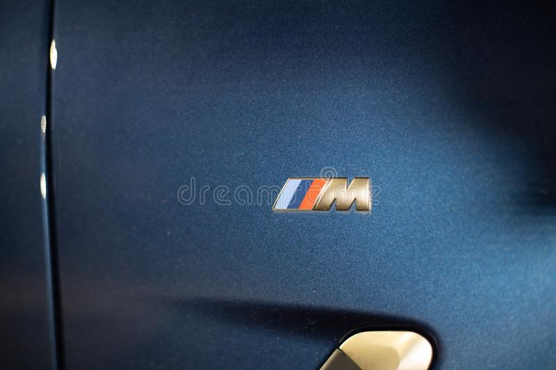 Moscow. Russia - December 06, 2019: M power logo on the car wing close up. The all-new BMW X3. Blue crossover stands on the. Street at night. Premium German royalty free stock photos